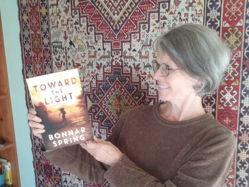 Bonnar holding copy of Toward the Light